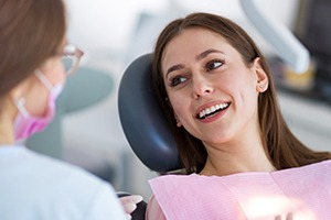 Young woman smiling in dental exam chair