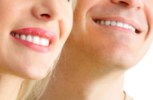 smiling couple with porcelain veneers