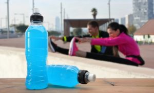 people stretching with sports drinks