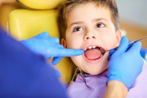 boy open mouth dentist
