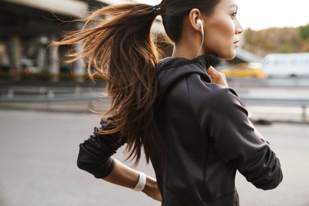 Closeup of woman running outside