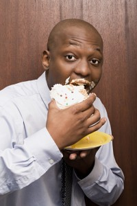 Man eating cake with food on mouth didn't get the facts on food and teeth from the dentist office lakewood dallas prefers