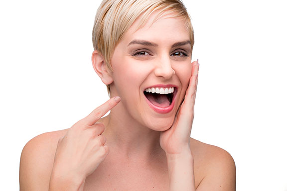 Woman with beautiful smile after porcelain veneers